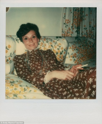 A polaroid showing #audreyhepburn relaxing on the #sofa with a #cigarette// #AndyWarhol: Polaroids 1958 - 1987